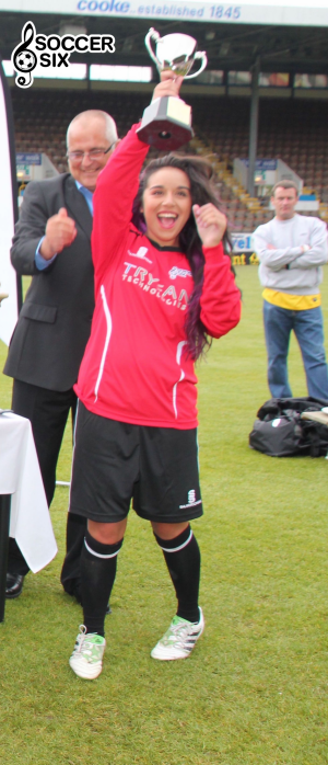 CHELCEE GRIMES LIFTS TROPHY